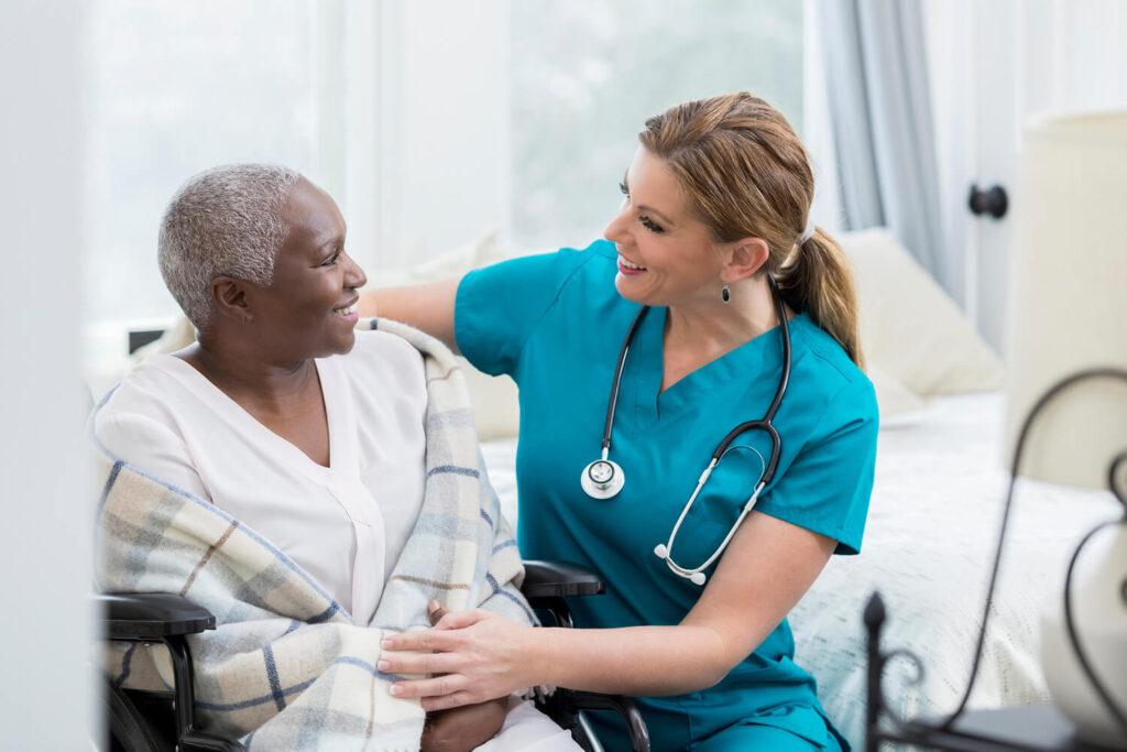 nurse cares for an elderly woman